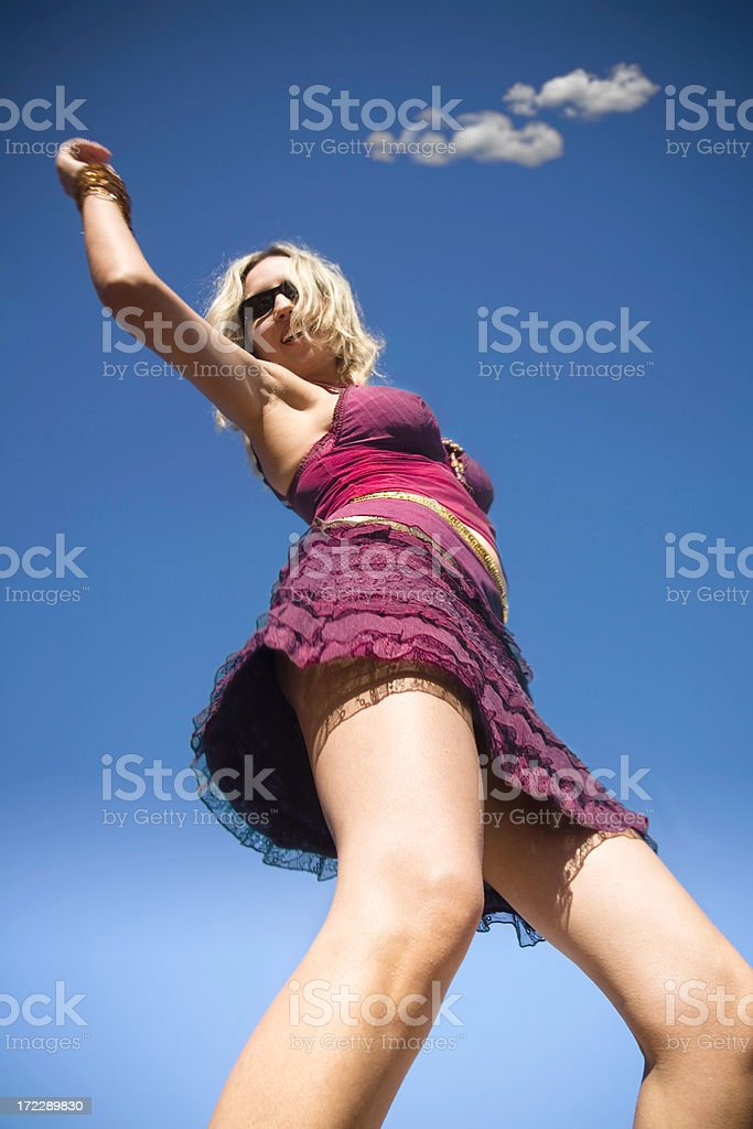 Dancing in the sun - Girl  with blue sky royalty-free stock photo