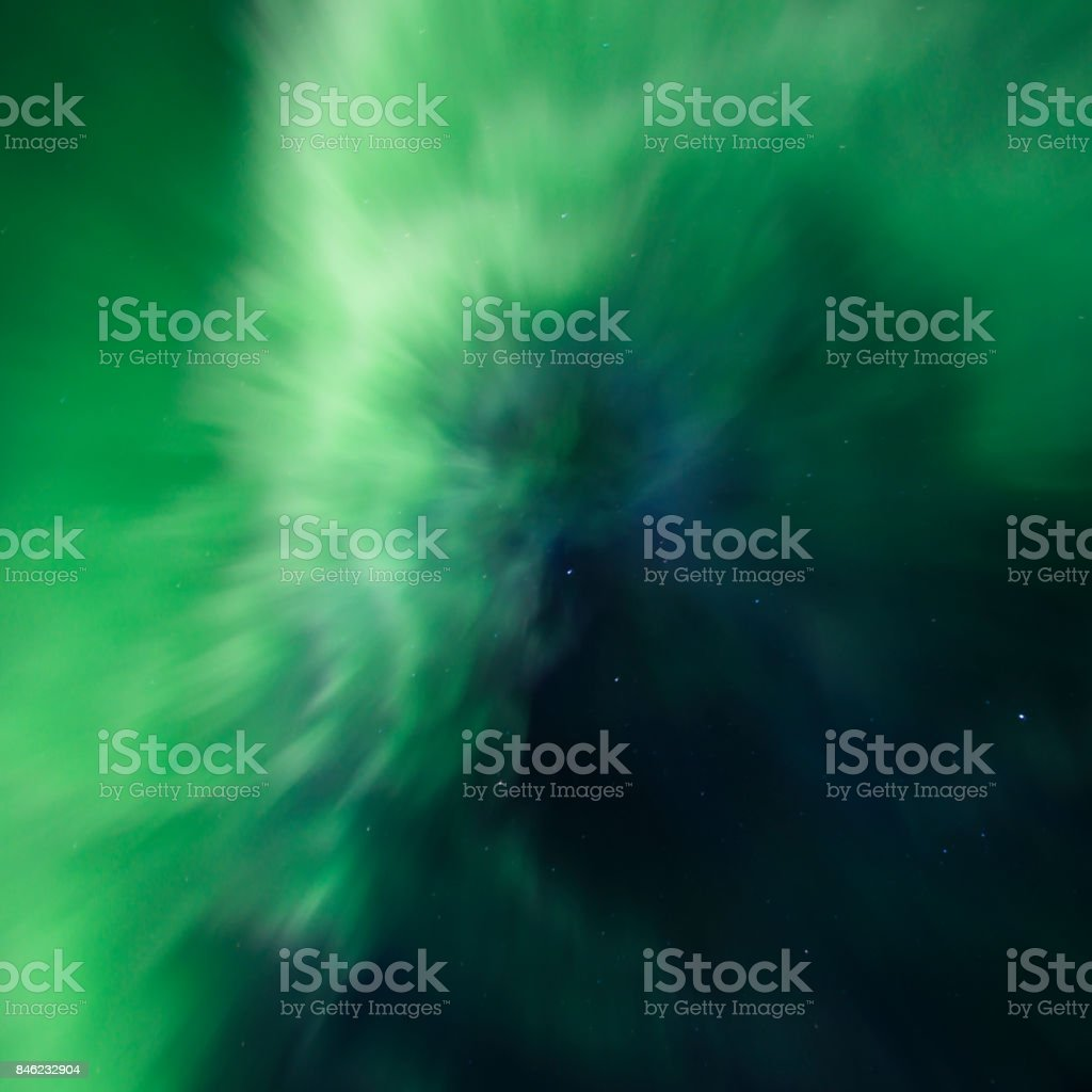 Dancing incredibly bright Aurora borealis (Northern lights) on the sky under the Iceland stock photo