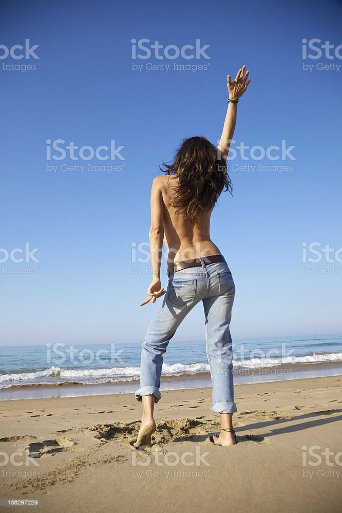 dancing jeans woman at beach royalty-free stock photo