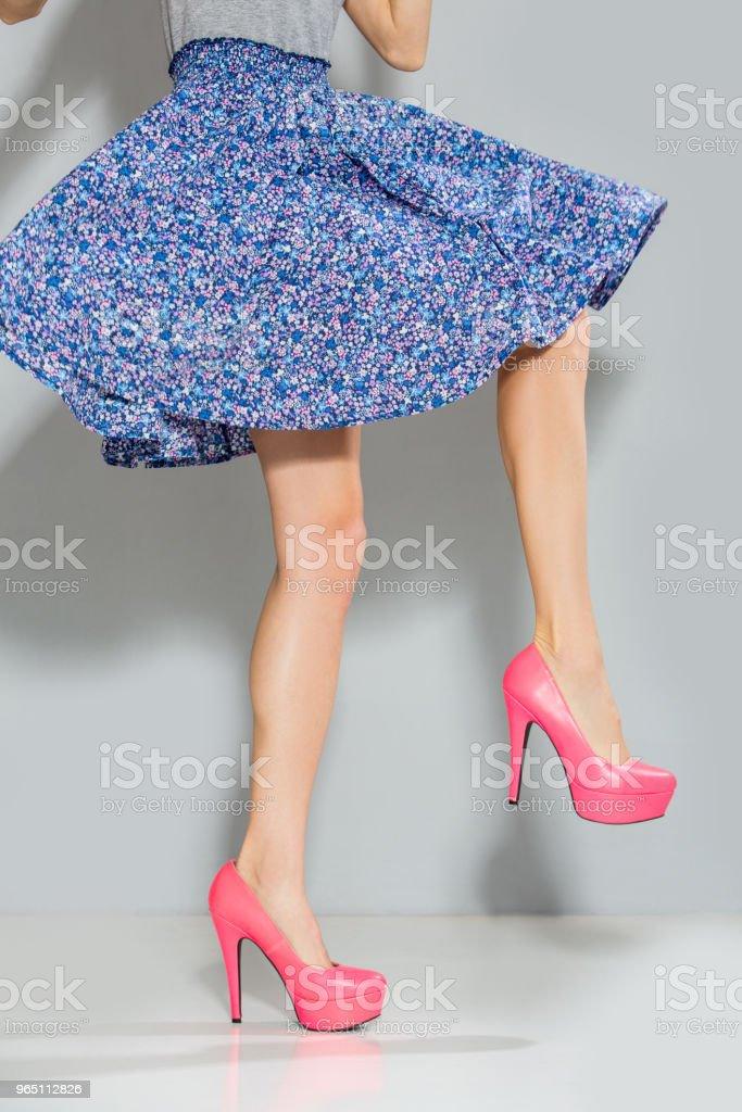 Dancing lady in floral dress zbiór zdjęć royalty-free