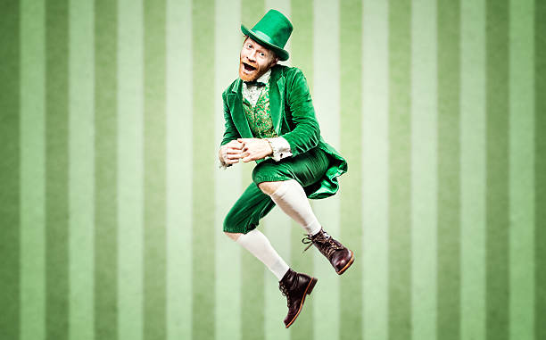 dancing leprechaun man on st. patricks day - st patricks day stock photos and pictures