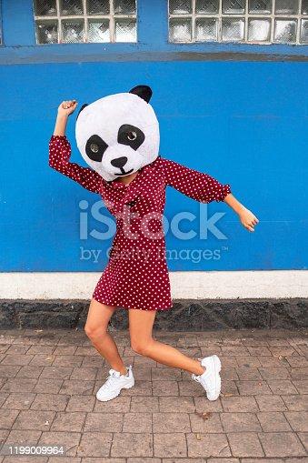 A young woman in panda costume dancing