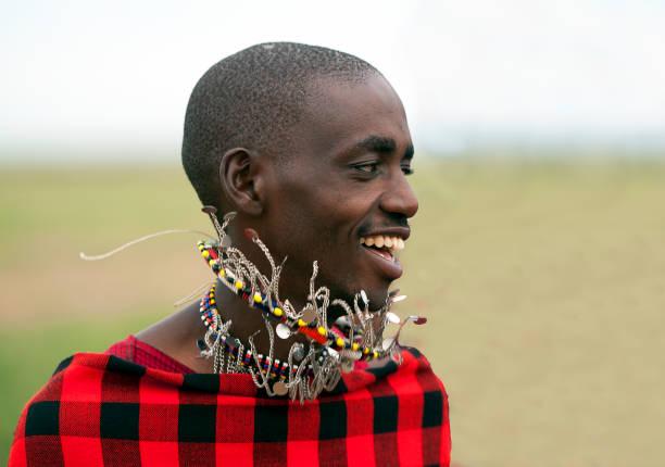 Dancing Maasai, Masai Mara, Kenya, Africa stock photo