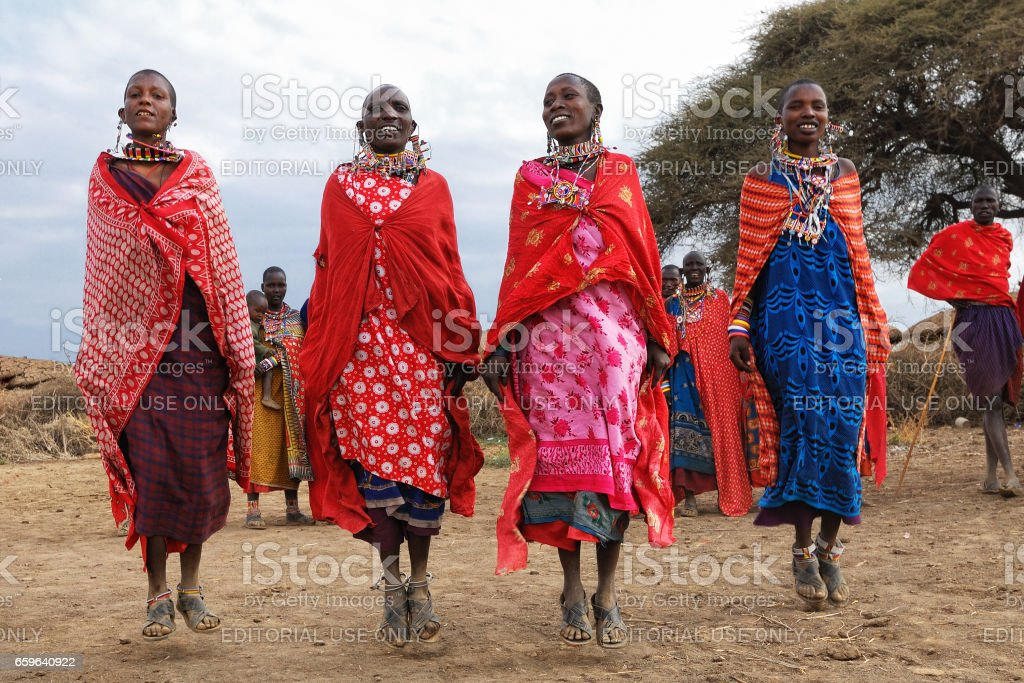 Dancing Masai women stock photo