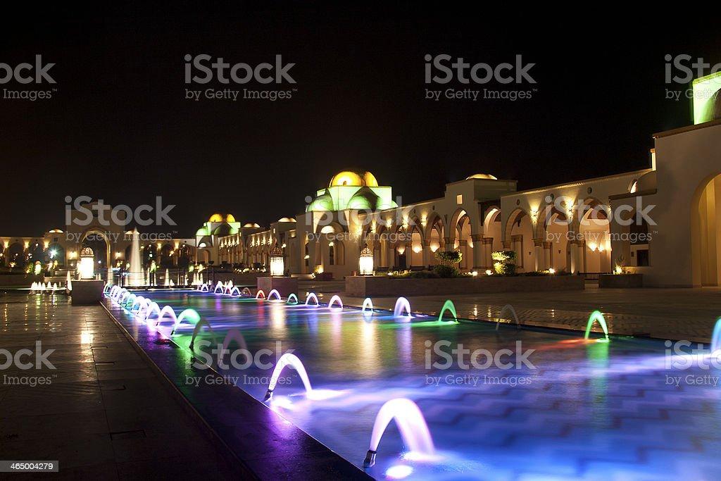 Dancing Multi Colored fountain at dark night stock photo