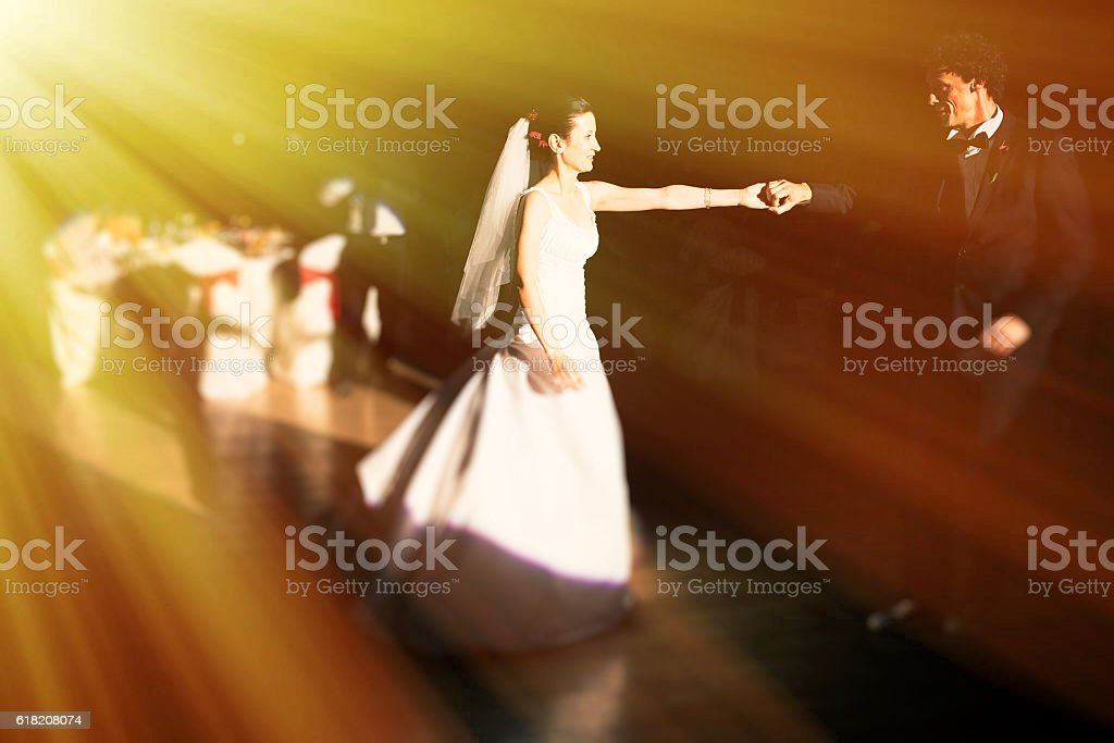 Dancing newlyweds stock photo