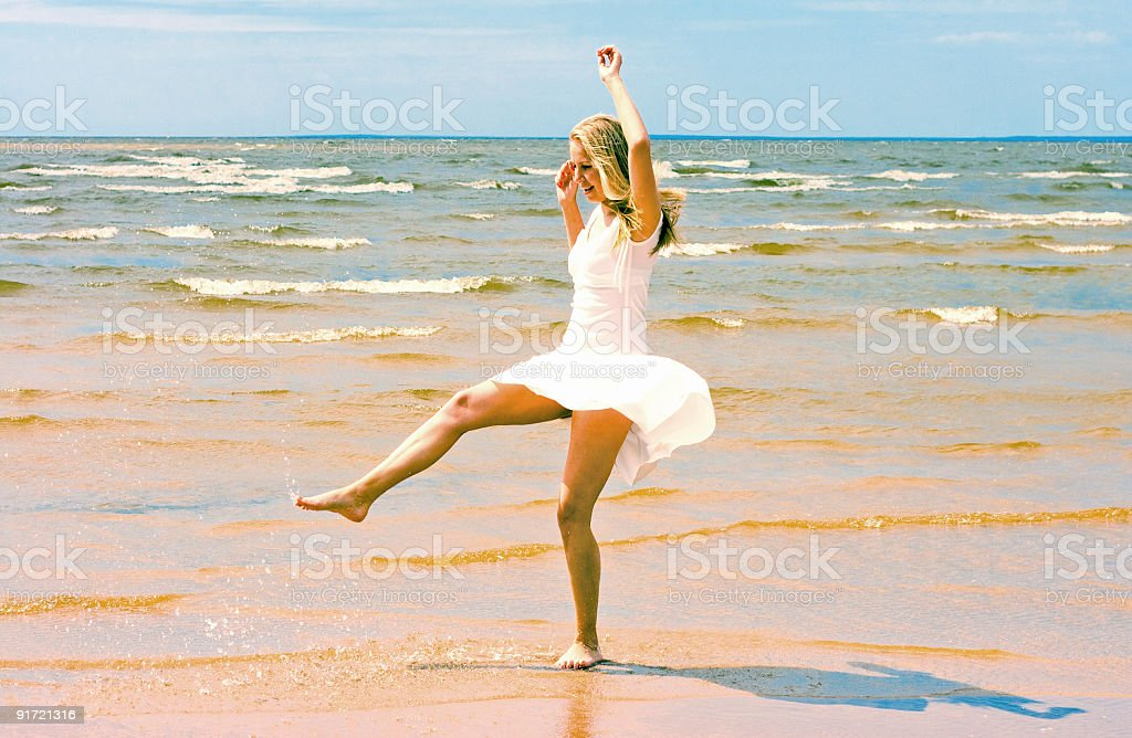 dancing on a beach royalty-free stock photo