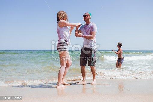 Young, beautiful, happy people dancing on the beach of Albena, Bulgaria.