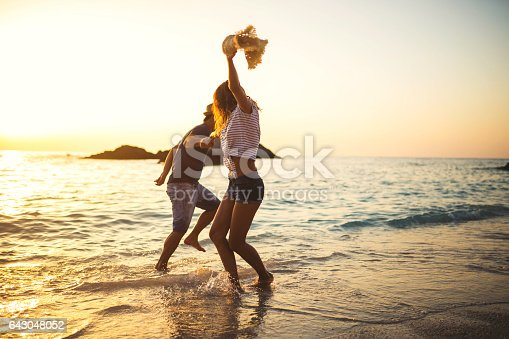 Young couple having fun by the sea,dancing and being happy