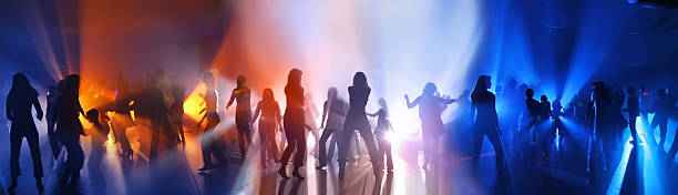 Dancing people in a disco Dancing people in a disco entertainment club stock pictures, royalty-free photos & images