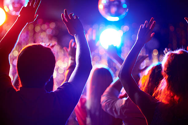 dancing people - disco ball stock pictures, royalty-free photos & images