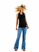 Picture of a girl dancing. Twisting her head from side to side.