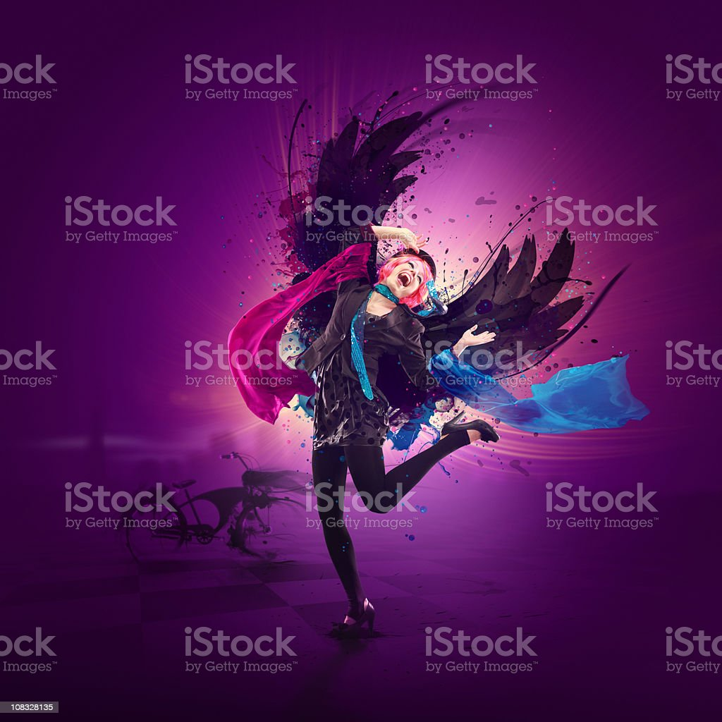 Dancing queen with wings and colorful design around her stock photo