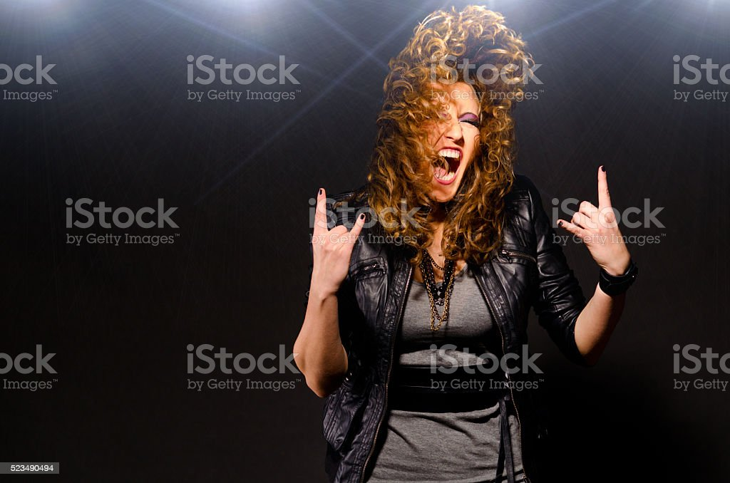 dancing to the rock music stock photo