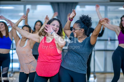 897892972 istock photo Dancing Together 989174676