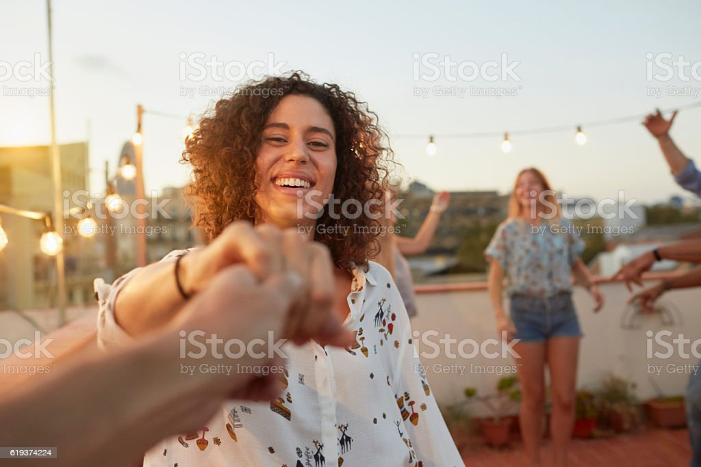 Dancing with my girlfriend at a rooftop party from pov stock photo