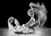 powder splashing beautiful woman face