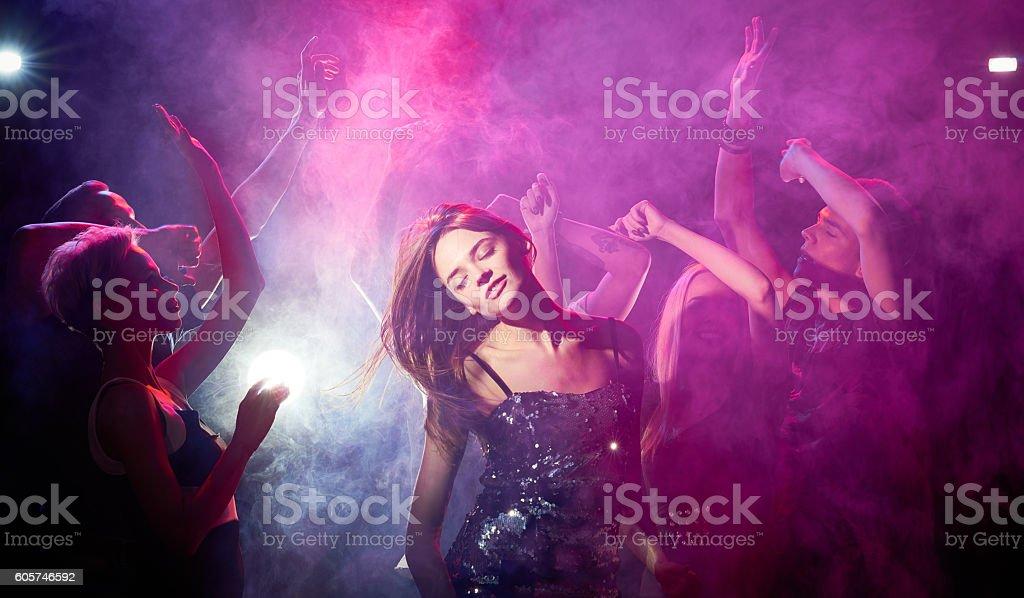 Dancing woman at party stock photo