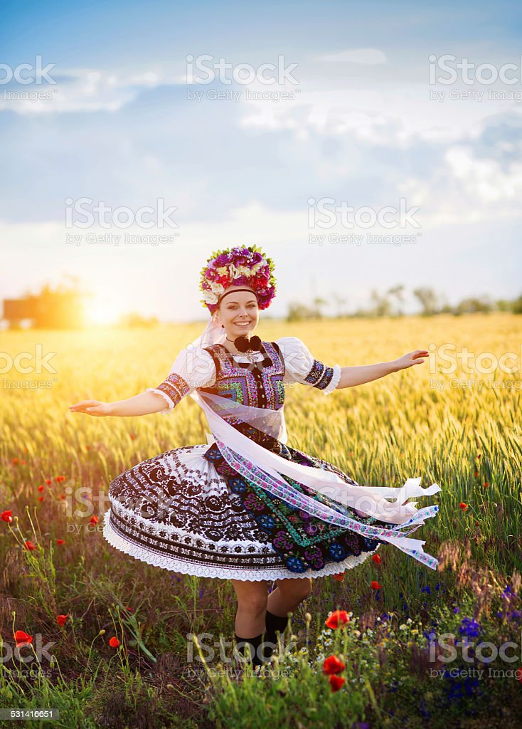 Dancing woman in sunset stock photo