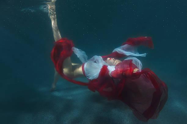 dancing woman underwater. - meerjungfrau kleid stock-fotos und bilder