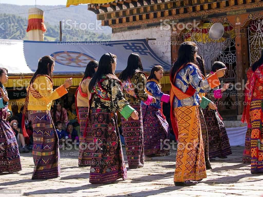 Dancing women wearing traditional kira dresses stock photo