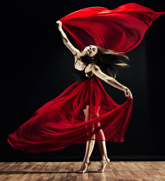 Dancing young woman with black and red dress stock photo
