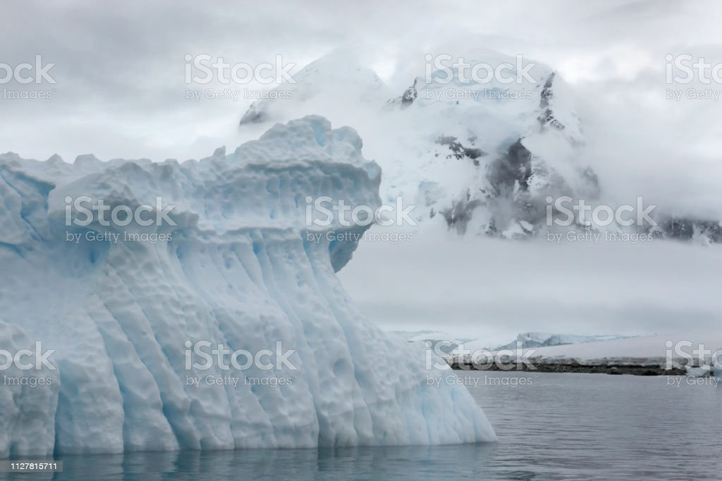 Danco Island mountain iceberg gentoo penguins Antarctica Gerlache Strait Antarctica stock photo