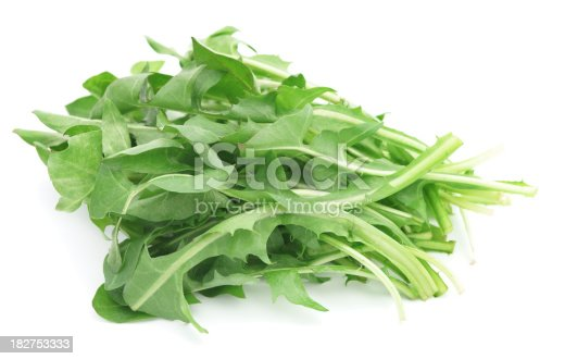 Dandelion greens isolated on white