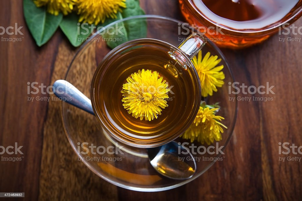 dandelion tisane tea with yellow blossom inside teacup stock photo