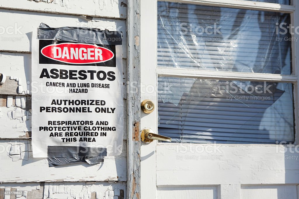 Danger Asbestos Sign near House Entry Door stock photo