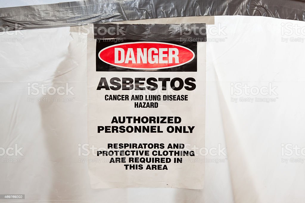 Danger Asbestos Sign on Temporary Plastic Containment Area Door stock photo
