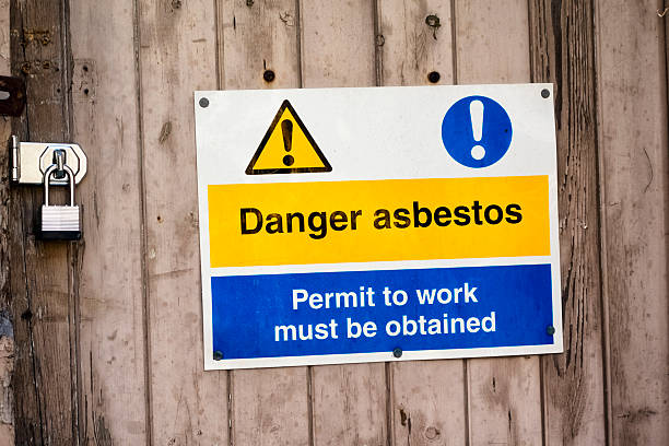 Danger asbestos - sign outside a derelict building stock photo