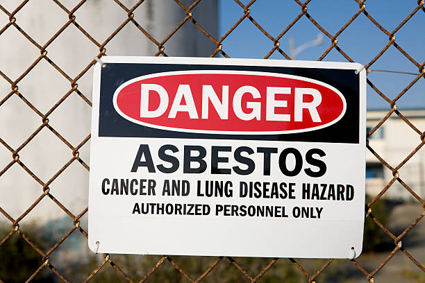 danger asbestos warning sign - bioremediation stock photos and pictures