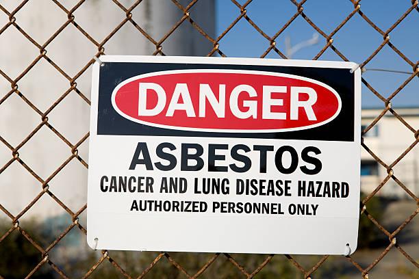 Segnale di avvertimento di pericolo di amianto - foto stock