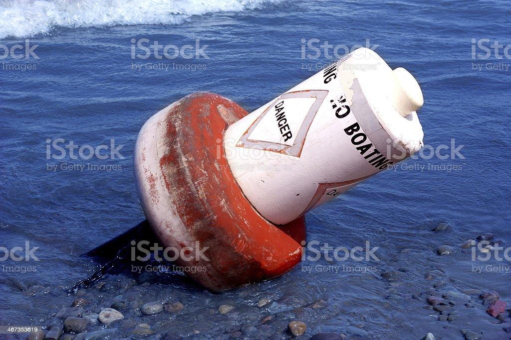 Danger Buoy Toppled royalty-free stock photo