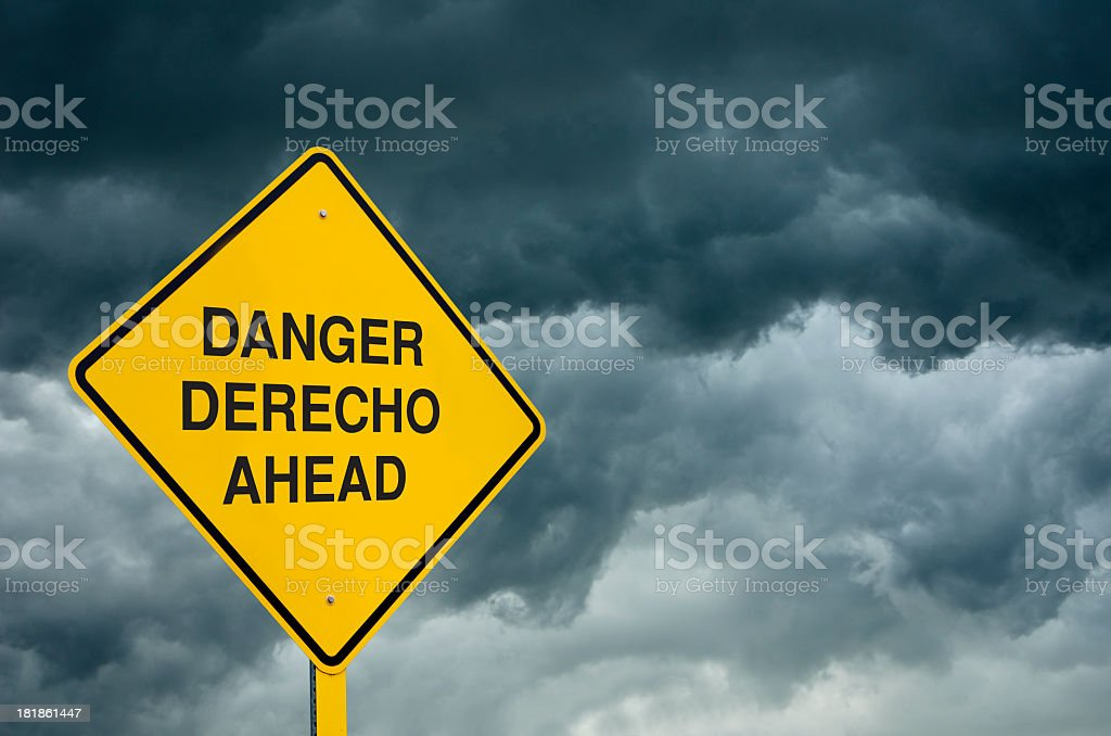 A 'danger' caution sign in front of storm clouds royalty-free stock photo