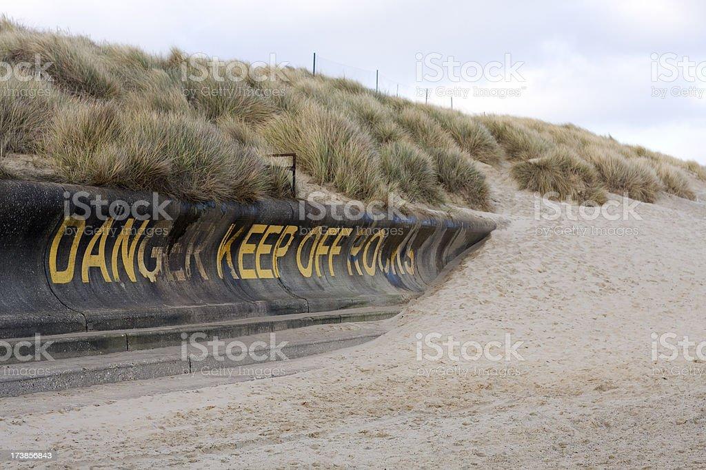 Danger, coastal erosion stock photo