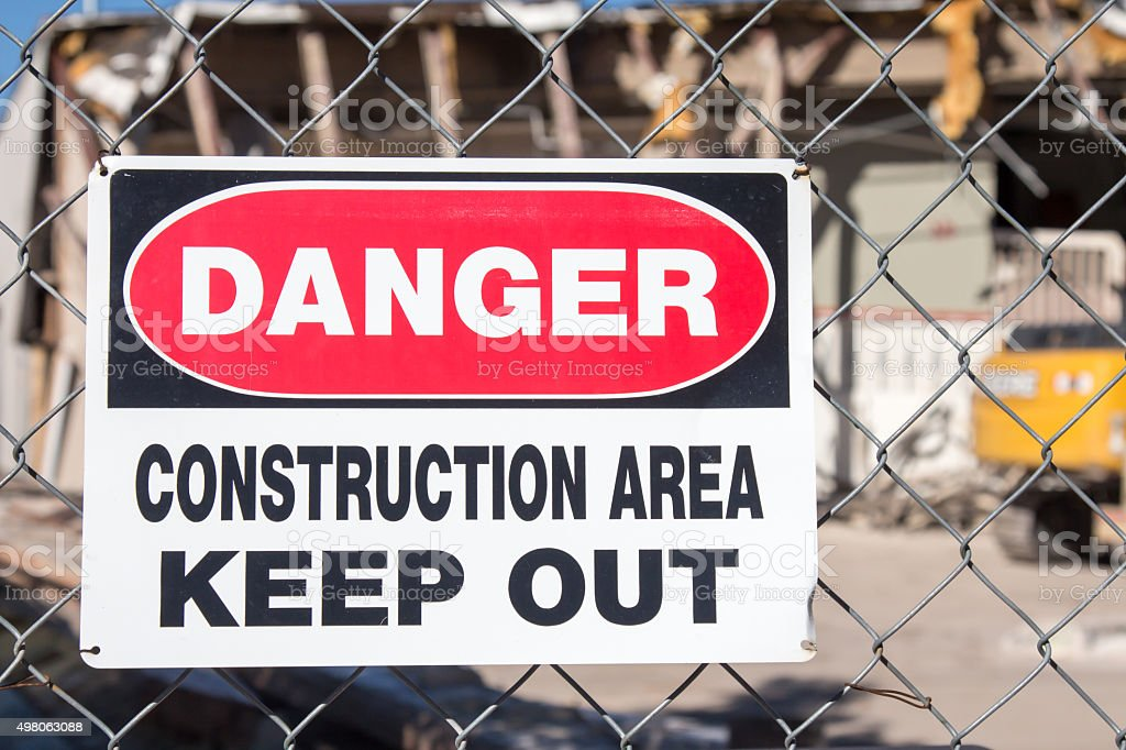 Danger construction area sign in front of demolition stock photo