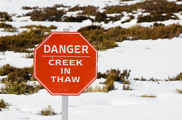 Danger creek in thaw sign