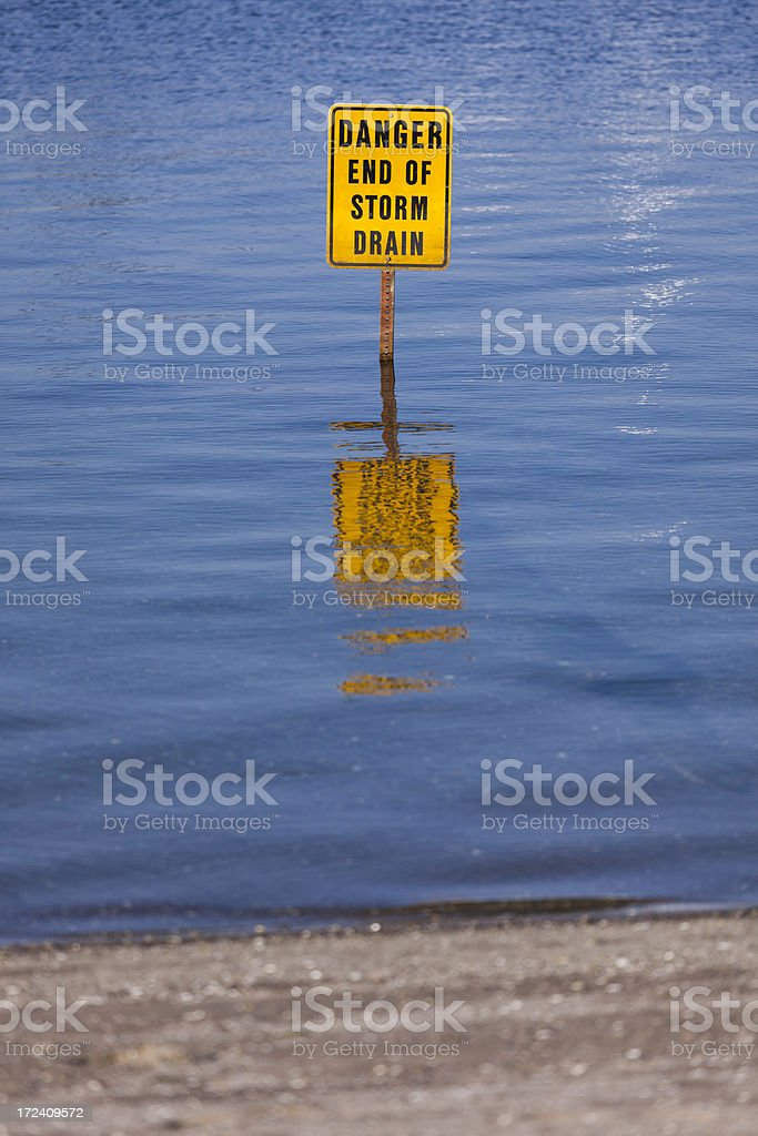 Danger end of storm drain sign royalty-free stock photo