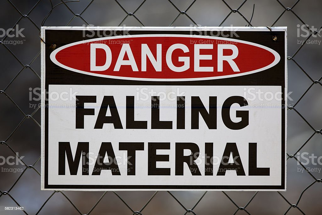 Danger Falling Material Sign stock photo