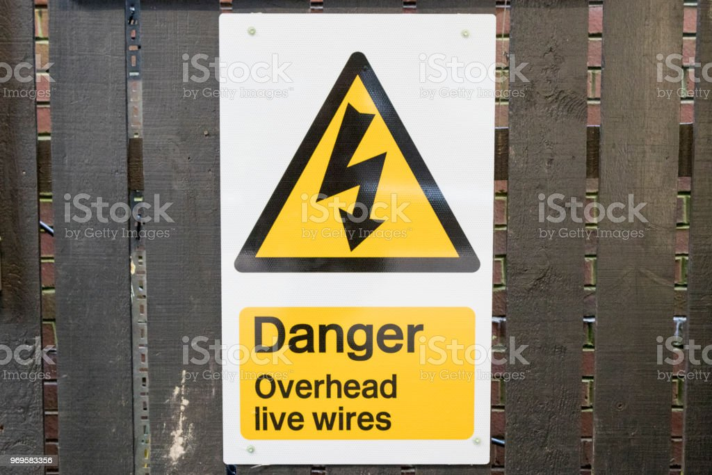 Danger high voltage sign on a fence stock photo