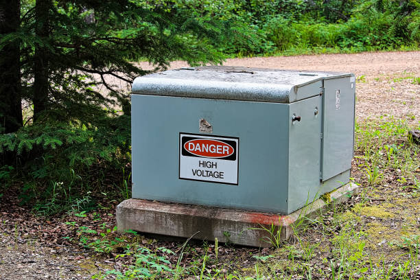 a danger high voltage sign on an electrical box - transformers stock photos and pictures