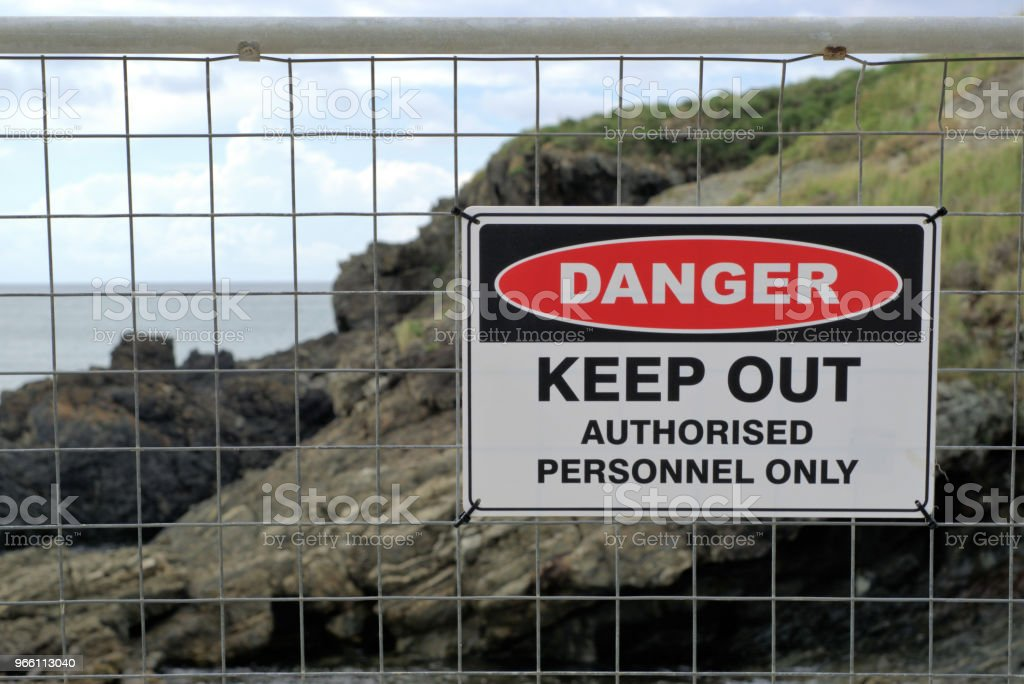 Danger Keep Out Authorized Personnel Only' sign board - Royalty-free Australia Stock Photo