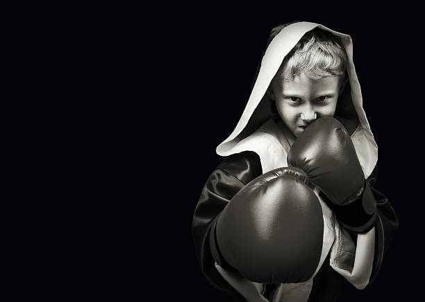 Danger looking young boxing fighter stock photo