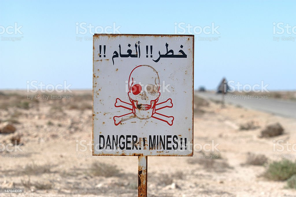 Danger minefield sign stock photo