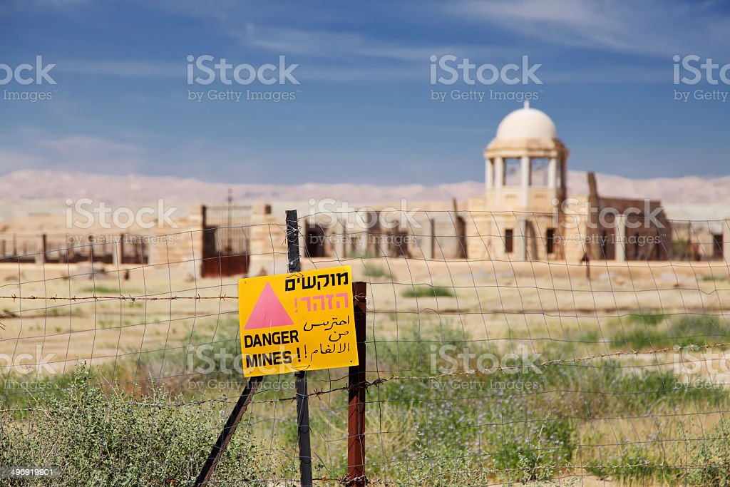 Danger Mines sign on fence in Israel at Qasr-el-Yahud site stock photo