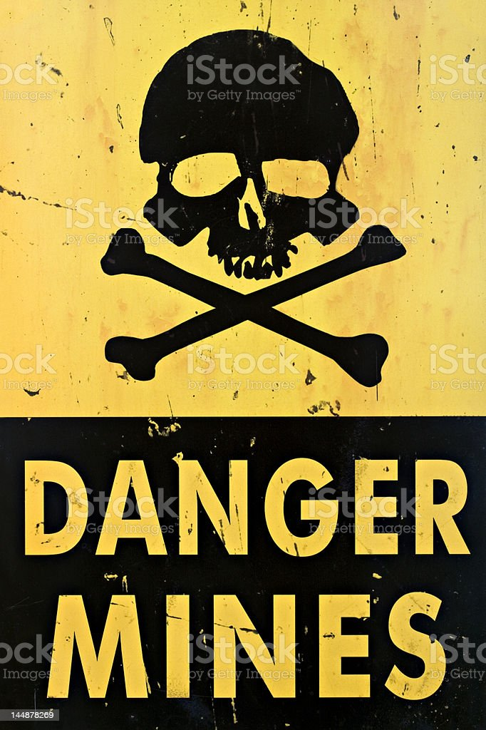 danger mines warning sign closeup stock photo