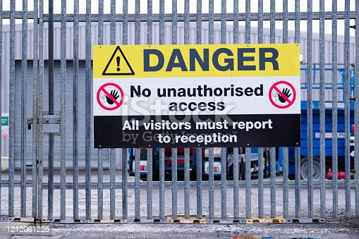 Danger no unauthorised access, all visitors must report to reception sign uk