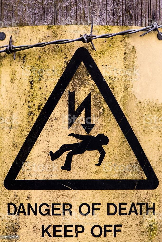 Danger of Death sign and barbed wire stock photo